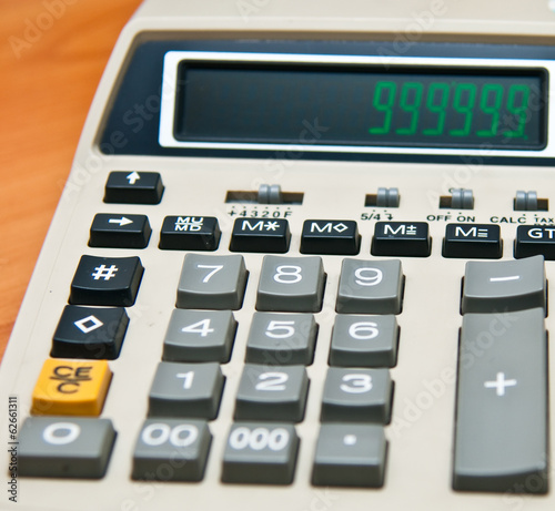 Calculator on wood texture background, may use as business, fina