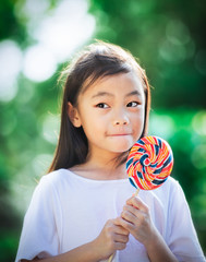 Girl eating a colorful candy