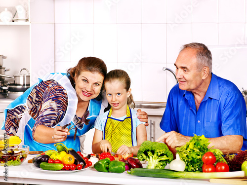 Family with child cooking at kitchen.