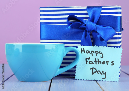 Happy Fathers Day tag with gift box and cup,