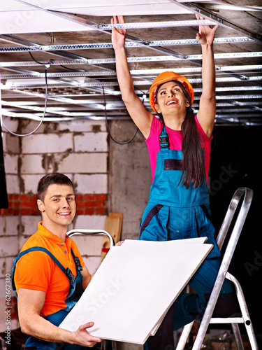 People  installing suspended ceiling