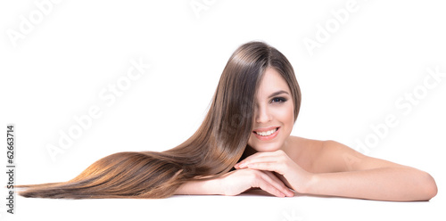 Beautiful young woman with long hair isolated on white