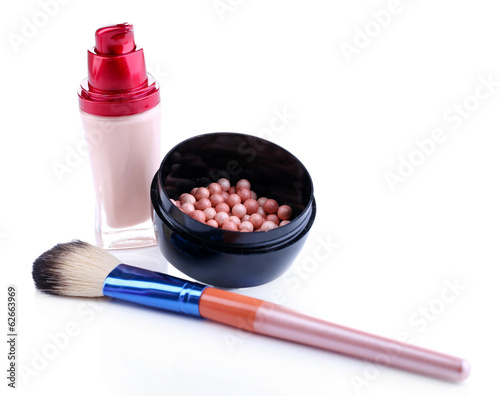 Composition with concealer, powder balls and brush isolated
