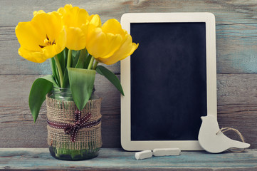 Tulips with blank blackboard