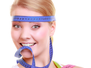 Obsessed girl with violet measure tapes around her head