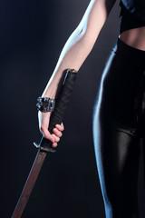 woman holding samurai sword