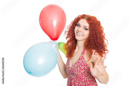 Happy young woman holding colorful balloons