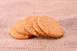 Freshly baked home made cookieson sackcloth background