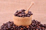 Pile of coffee beans on sackcloth background