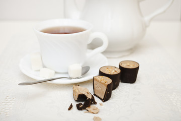 chocolates and tea in a cup