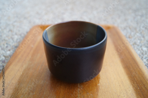 black cup on tray