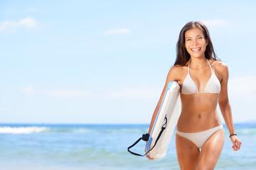 Woman surfer girl on beach