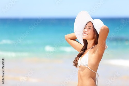 Beach woman relaxing on travel vacation