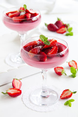 panna cotta dessert with strawberry sirup - Stock Image