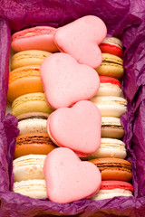 French colorful macarons with hearts in box