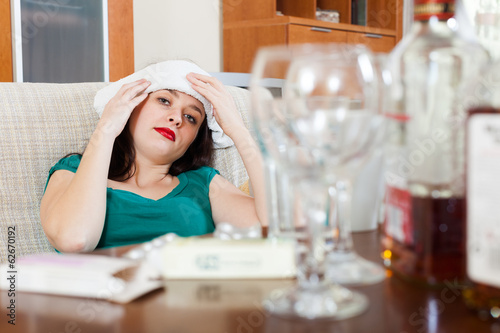 woman having headache in morning after party