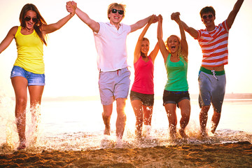 Group of happy teenagers at the beach