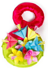 Seven colored paper flowers and symbol for 8 of March