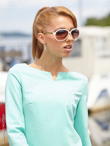 Young fashion woman in port