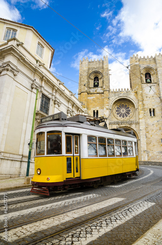 Leinwandbild Motiv Romantic Lisbon street with the typical yellow tram