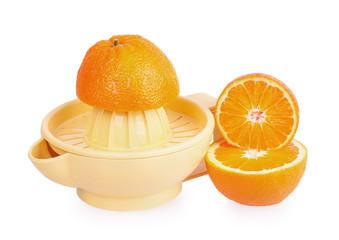 Orange plastic citrus juicer and oranges
