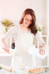 Happy young woman in the kitchen