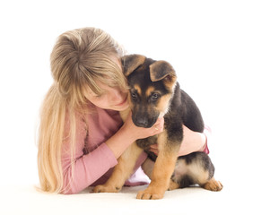 young woman affectionately hugging a puppy