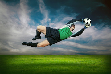 Football goalkeeper in action outdoors