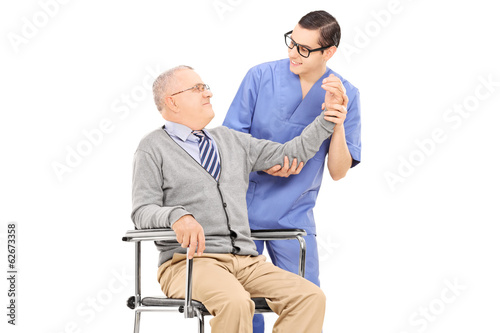 Physiotherapist doing a physical exam on senior gentleman
