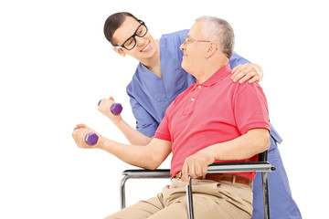 Physiotherapist showing an exercise to a mature man