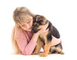 woman tenderly embraces a German Shepherd puppy