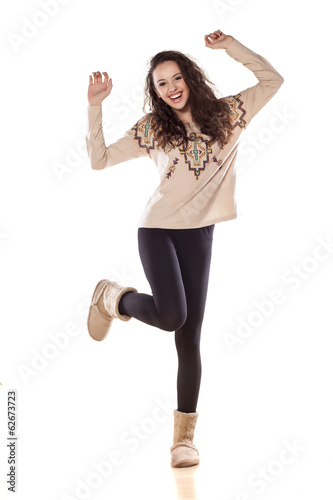 happy pretty girl dancing on white background