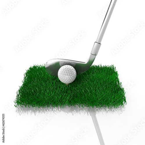 Golf club with ball on green patch of grass