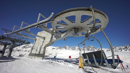 ski lift chair station on slope in high mountain