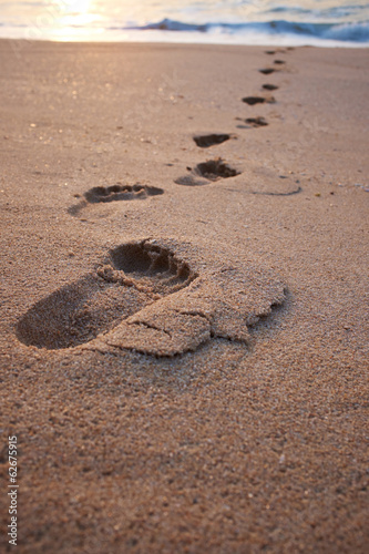 Footprints on the beach sand.Traces on the beach. Footsteps on t © ZoomTeam