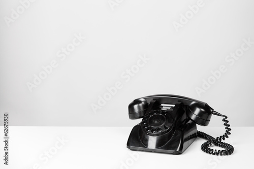 vintage black telephone on grey background
