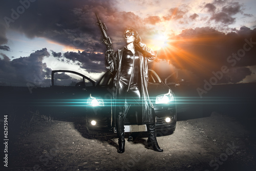 Armed woman with machinegun over cloudy sky