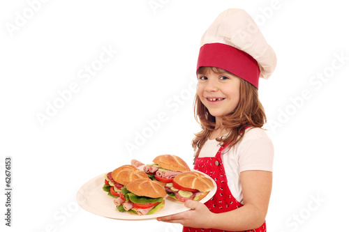 happy little girl make sandwiches
