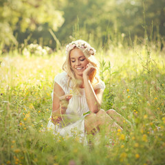 Attractive blonde lying in the field