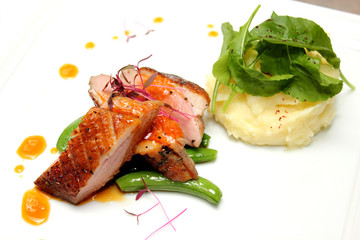 Duck breast with orange sauce and mash totato