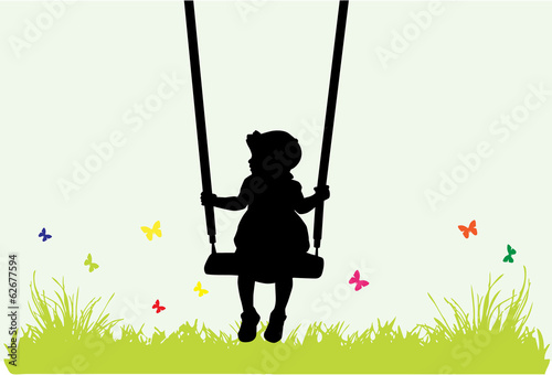Little girl on a swing .