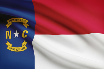 Series of ruffled flags of US states. State of North Carolina.