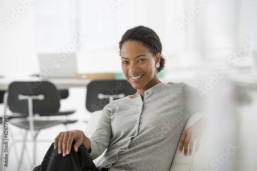 Business. A Woman Seated On The Sofa Looking Relaxed.