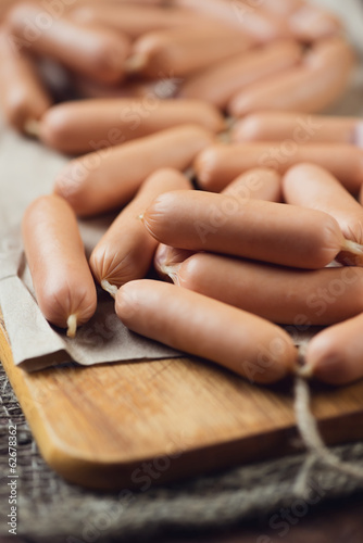 Close-up of raw sausages, vertical shot, shallow depth of field