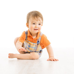 Child happy smiling, small one year boy crawling over white