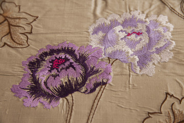 Fabric with floral design ornaments