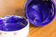 The opened jar with gouache of blue color