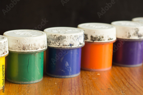 Some old cans with gouache of different color