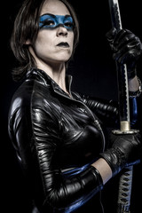 Blue mask, Woman with katana sword in latex costume
