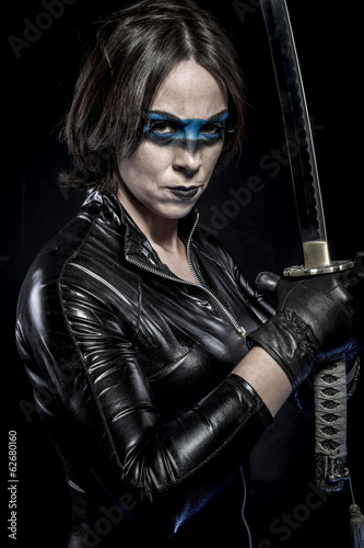 Danger, Woman with katana sword in latex costume